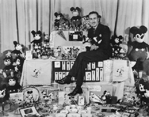 Disney sitting with Mickey Mouse merchandise